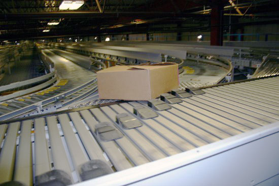 Conveyors and sorters for pallets and cartons